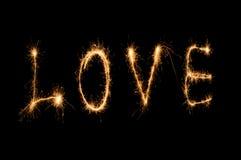 Бенгальский огонь слова влюбленности Стоковое Фото