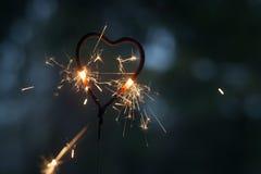 Бенгальский огонь формы сердца Стоковые Изображения RF