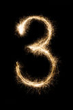 Бенгальский огонь 3 шрифта Нового Года на черной предпосылке Стоковое Изображение RF