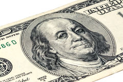 Бен Franklin& x27; сторона s с падениями воды на глазах на старой долларовой банкноте США $100 Стоковое фото RF