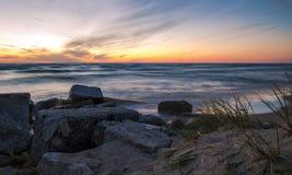 Берег захода солнца Стоковые Фото