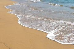 Берег и пена океана Стоковая Фотография