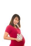 Беременная женщина держа настенные часы свое время Стоковое Изображение