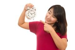 Беременная женщина держа настенные часы Стоковая Фотография