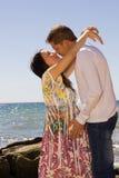 Беременная женщина и ее супруг на предпосылке o Стоковое Фото