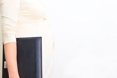 Беременная женщина на работе Стоковая Фотография