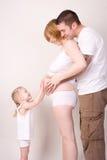 беременная женщина семьи Стоковое Изображение RF