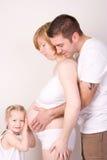 беременная женщина семьи Стоковое Фото