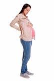 Беременная женщина смотря ее рему стоковая фотография rf