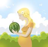 Беременная женщина с арбузом Стоковые Изображения