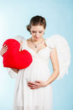 Беременная женщина с крылами ангела Стоковое фото RF