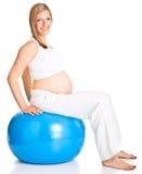 беременная женщина excercises Стоковое Фото