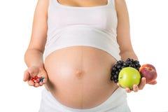 Беременность и питание, витамины стоковые фото