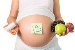 Беременность и питание, витамины стоковые изображения