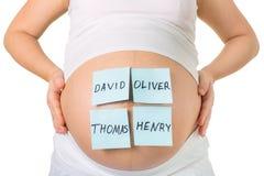 Беременность, мальчик или девушка, и имя ребенка стоковое изображение