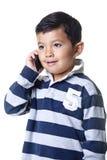 беседы телефона мальчика Стоковые Фото