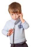 беседы телефона ребенка Стоковые Фотографии RF
