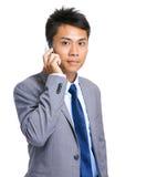 Беседа бизнесмена на телефоне Стоковое фото RF