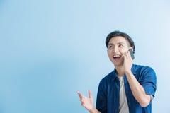 Беседа студента человека на телефоне Стоковая Фотография