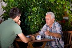 Беседовать в саде Стоковые Изображения RF