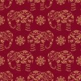Бесконечная текстура с стилизованным сделанным по образцу слоном и Пейсли в индийском стиле Стоковые Фото
