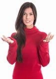 Беспомощная унылая женщина при красный пуловер изолированный на белизне Стоковая Фотография