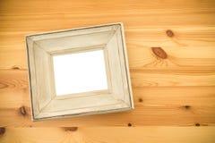 Белая деревянная рамка на таблице Насмешка вверх Стоковые Изображения RF