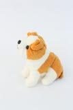 Белая кукла собаки с коричневыми ушами Стоковое Фото
