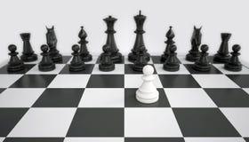 Белая пешка перед армией черных шахматных фигур стоковое фото rf