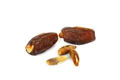 Белая предпосылка в плите с плодоовощ и плодоовощ даты осеменяют изображения Стоковое Фото