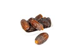 Белая предпосылка в плите с плодоовощ и плодоовощ даты осеменяют изображения Стоковая Фотография
