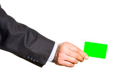 Белая пластичная карточка в изолированной руке человека Стоковое фото RF