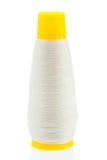 Белая резьба на желтой катушке стоковые изображения rf