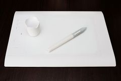 Белая таблетка графиков ручки Стоковое Изображение RF