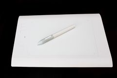Белая таблетка графиков ручки Стоковые Фото