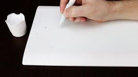 Белая таблетка графиков ручки Стоковое Изображение