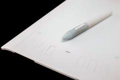 Белая таблетка графиков ручки Стоковое фото RF