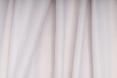 Белая ткань с розовой тенью в створках Стоковое фото RF