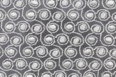 Белая ткань с спиральными формами Стоковые Изображения