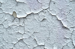 Белая треснутая краска на стене Стоковое фото RF