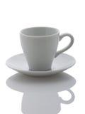Белая чашка на белой предпосылке Стоковые Фото