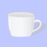 Белая чашка на голубой предпосылке Стоковое Изображение