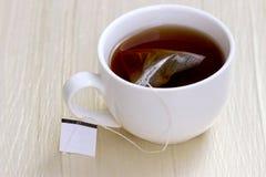 Белая чашка чаю стоковые фото