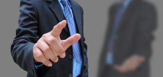 белизна бизнесмена предпосылки изолированная рукой стоковые фотографии rf