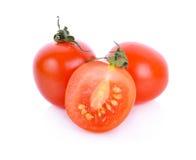 белизна взгляда сверху томатов предпосылки зрелая Стоковая Фотография