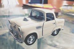 белизна игрушки предпосылки изолированная автомобилем Стоковая Фотография RF