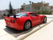 белизна игрушки предпосылки изолированная автомобилем Стоковые Фото