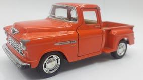 белизна игрушки предпосылки изолированная автомобилем стоковое фото