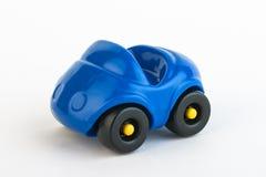 белизна игрушки предпосылки изолированная автомобилем Стоковое Изображение