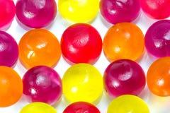 белизна конфеты предпосылки цветастая Стоковое Фото